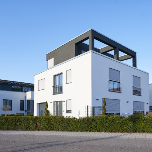 New modern cube shaped house with a large windows in a new area